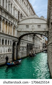 Famous Bridge of Sighs with gondolas. The enclosed bridge is made of white limestone connect Doge's Palace and new prison.