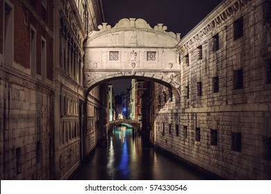 Famous Bridge of Sighs (Ponte dei Sospiri) landmark at night, Venice (Venezia), Italy, Europe, Vintage filtered style