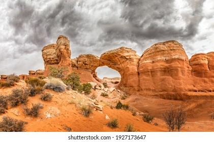 The famous Broken Arch in the Arches National Park, Utah and dramatic dark clouds - Shutterstock ID 1927173647