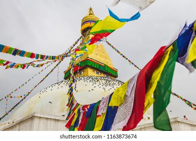 Famous Buddhist Shrine Boudhanath Stupa with Prayer Flags and Pigeons in Kathmandu Nepal,is one of the largest stupas in the world.Boudhanath Stupa is also a UNESCO World Heritage Site.