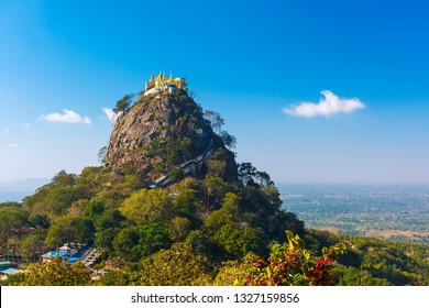 Famous buddhist temple on the summit of Taung Kalat volcano near Mt. Popa. 777 stairs have to be climbed barefoot along with monkeys to reach the top, end of pilgrimage. Myanmar