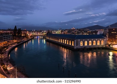 Famous building BFM in Geneva at night. Landscape with view on the Rhone river and Saint-Piere cathedral.