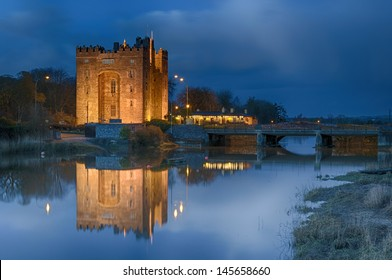 famous bunratty castle and durty nelly's pub, county clare, ireland. picturesque epic beautiful river castle pub landmark for tourists. world european irish castle. ireland castle beside irish pub .