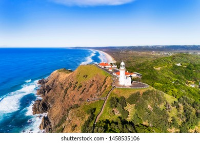 Famous Byron Bay white lighthouse on the top of Headlands on Australian pacific coast overlooking wide sandy beaches at the most eastern point of Australian mainland.