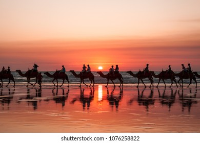 famous cable beach sunset camel rides with smoke on the horizon