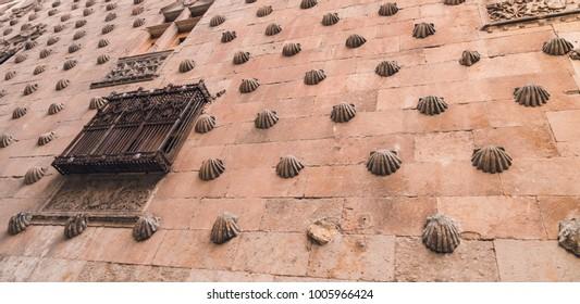 Famous Casa de las Conchas with La Clerecia Church in Salamanca, Castilla y Leon, Spain