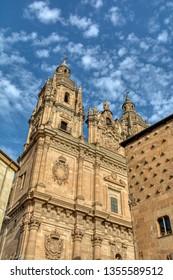 Famous Casa de las Conchas with La Clerecia Church in Salamanca, Castilla y Leon, Spain.