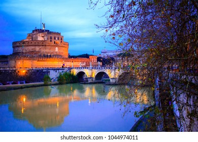 Famous Castel Sant'Angelo over Tiber river in Rome, Italy. Pictuer is taken during the blue hour, between day and nightfall which reveals bright colors and nice illumination.