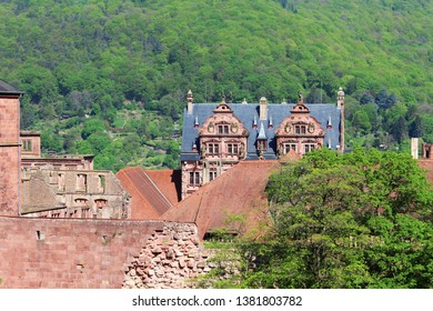 Famous castle of Heidelberg, surrounded by the hilly landscape with forest
