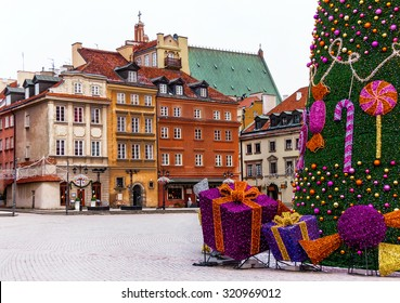 Famous castle square of Warsaw with colorful medieval houses, christmas tree and gifts. Old  town. Winter. Poland. Travel, vacation, new year, christmas concept. Copy space. Place for you message.
