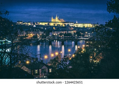 Famous castle and Vltava river from Vysehrad, Prague, Czech republic. Night scene. Travel destination. Architectural scene. Analog photo filter with scratches.