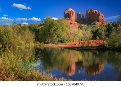 The famous Cathedral Rock sandstone formation and it's  reflection in the Oak Creek River, Red Rock State Park, Sedona, Arizona.
