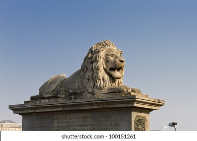 The famous Chain Bridge across the Danube in Budapest, Hungary, Europe. Lion statue.
