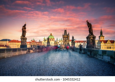 Famous Charles Bridge and cityscape of Prague with medieval towers and colorful buildings, Czech Republic