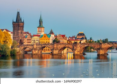 Famous Charles bridge and historical center of Prague, buildings and landmarks of old town at sunset, Prague, Czech Republic - Shutterstock ID 1696900297