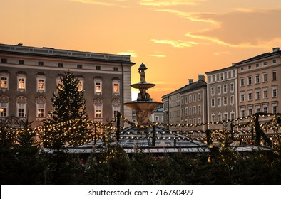 famous christkindlmarkt salzburg with illuminated christmas trees and garlands at sunset