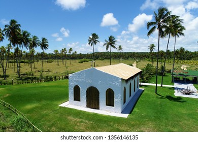 Famous church on the beach in São Miguel dos Milagres, Alagoas, Brazil. Beauty landscape with several palm trees. Travel destination. Vacation travel. Tropical travel.