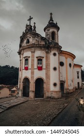 The famous Church of Saint Francis of Assisi, a Rococo Catholic church in Ouro Preto, Brazil in a cloudy sky morning. Ouro Preto, Minas Gerais, Brazil.