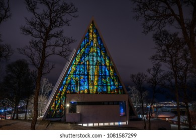 The famous church in Tromso in northern norway. It is located on a hill on top of the city centre as is known for its architecture and illumination