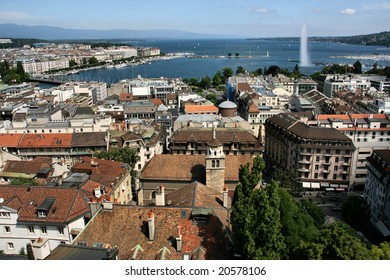 Famous city of business - Geneva, Switzerland. Lake Geneva (Lac Leman), fountain and sailboats.