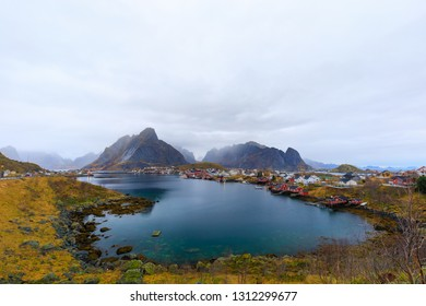 Famous city Reine in Lofoten, Norway in fall with cloudy sky