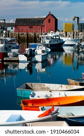Famous classic red fishing shack by wharf in Rockport Harbor in Massachusetts, with its colorful fishing and row boats, is a favorite destination for artists worldwide.