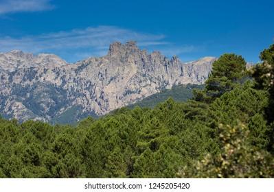 The famous Col De Bavella mountain in Southern Corsica near Porto Vecchio in France with blue sky