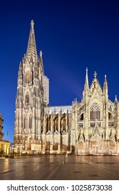 The famous Cologne Cathedral at night with deep blue sky,