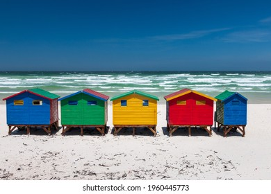 Famous colorful beach houses in Muizenberg near Cape Town, South Africa against blue sky