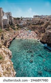 famous and crowded Lama Monachile Beach in Polignano a Mare, Puglia