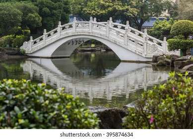 The famous curved bridge with its reflection at Chiang Kai Shek memorial hall on a sunny day, Taipei, Taiwan