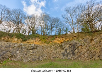 The famous de la Beche angular unconformity at Vallis Vale, Somerset, England. Jurassic limestone laid down on dipping Carboniferous limestone with a 180Ma age difference.