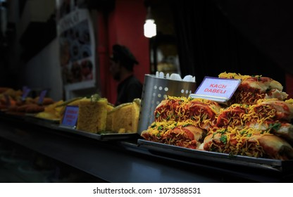 Famous delicious food Kach Dabeli on dispay in a shop from Food street, Bangalore, bengaluru, Karnataka, INDIA.