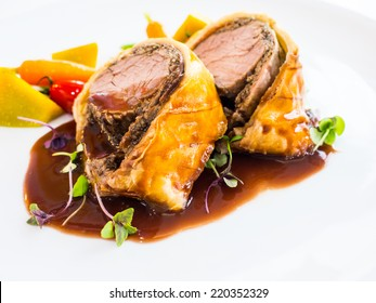 Famous dish, beef wellington with red wine sauce