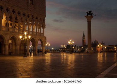 Famous Doge palace, column with winged lion and San Marco square at sunrise in Venice, Italy
