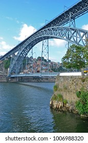 The famous Dom Luis I Bridge at Porto in Portugal which spans the River Douro in the heart of the city. It is a double-deck, steel arched bridge