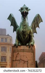 Famous dragon's sculpture on the Dragon's Bridge (Ljubljana - Slovenia). The dragon is the symbol of the Slovenian capital.