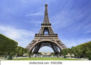 The famous Eiffel Tower in Paris against a dramatic blue sky