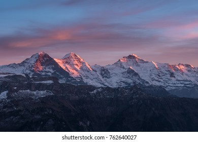 famous eiger, mönch and jungfrau above interlaken in the swiss alps panorama with sunset mood