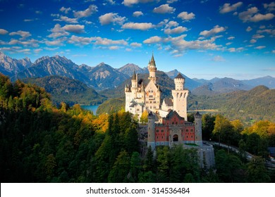 Famous fairy tale Castle in Bavaria, Neuschwanstein in Germany, morning with blue sky with white clouds.