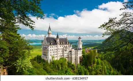Famous fairy tale Castle in Bavaria, Neuschwanstein, Germany, panoramic view with blue sky and white clouds