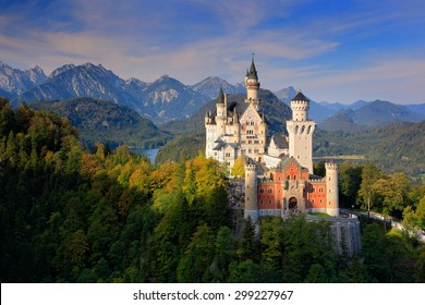 Famous fairy tale Neuschwanstein Castle in Bavaria, Germany, late afternoon with blue sky with white clouds.
