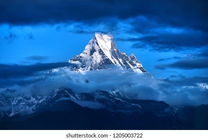 Famous Fishtail mountain peak in Nepal with beautiful clouds