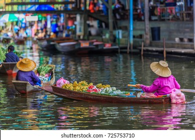 Famous floating market in Thailand, Damnoen Saduak floating market, tourists visiting by boat, Ratchaburi, Thailand.