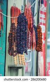 Famous food Churchkhela - traditional sausage-shaped candy - from the Tbilisi, Georgia street market. Various dried fruits and other stuff