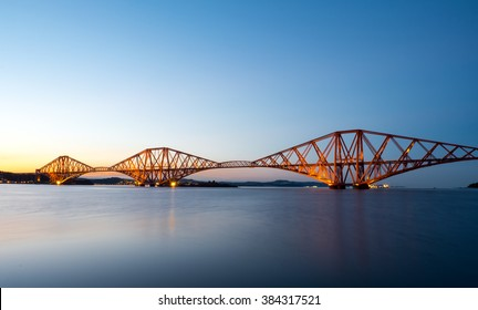 The famous Forth Rail Bridge in Scotland after sunset