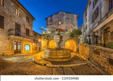 Famous fountain (La Grande Fontaine de 1850) at dusk in Saint Paul de Vence, Alpes-Maritimes, France