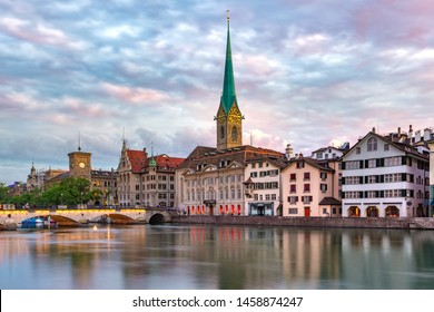 Famous Fraumunster church and river Limmat at sunrise in Old Town of Zurich, the largest city in Switzerland
