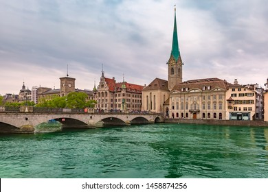 Famous Fraumunster church and river Limmat on the cloudy day in Old Town of Zurich, the largest city in Switzerland