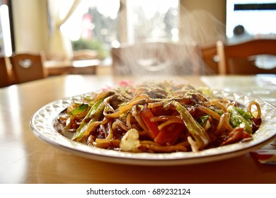Famous Fujinomiya Yakisoba with hot steam is served on the wood table